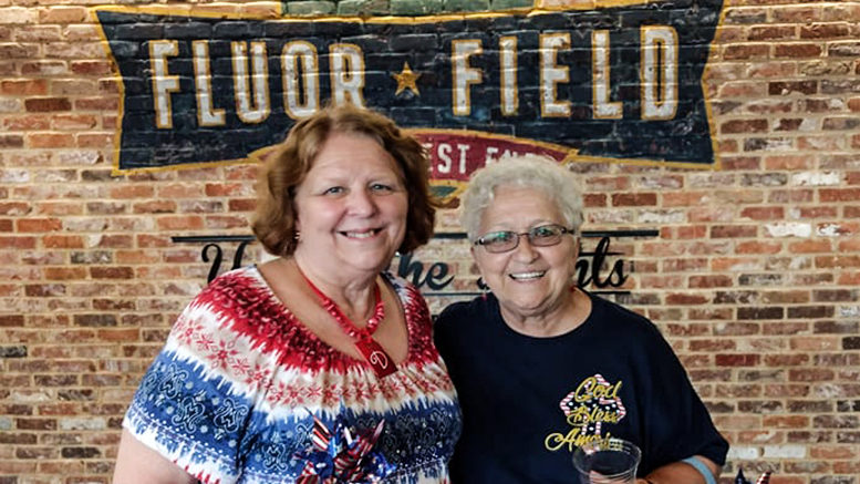 Two senior women are enjoying a nice day at Fluor Field in Greenville, South Carolina