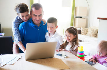 Parents with children around a computer